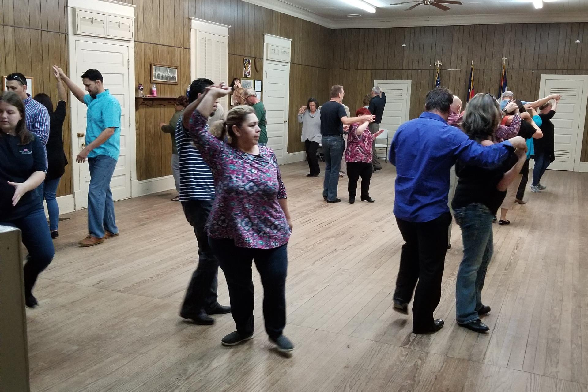 A group of adults dancing during a dance class