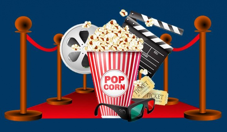Movie reel, popcorn bucket, 3D glasses and movie tickets on a red carpet