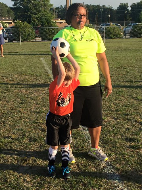 Nashville Parks and Recreation Referee with child on soccer field