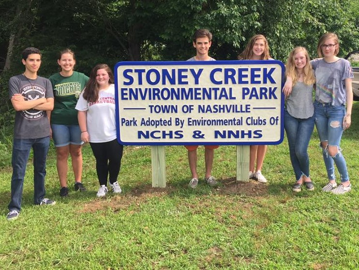 Stoney Creek Sign with Northern Nash High School Envrionmental Club Members